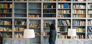 woman in front of book shelf